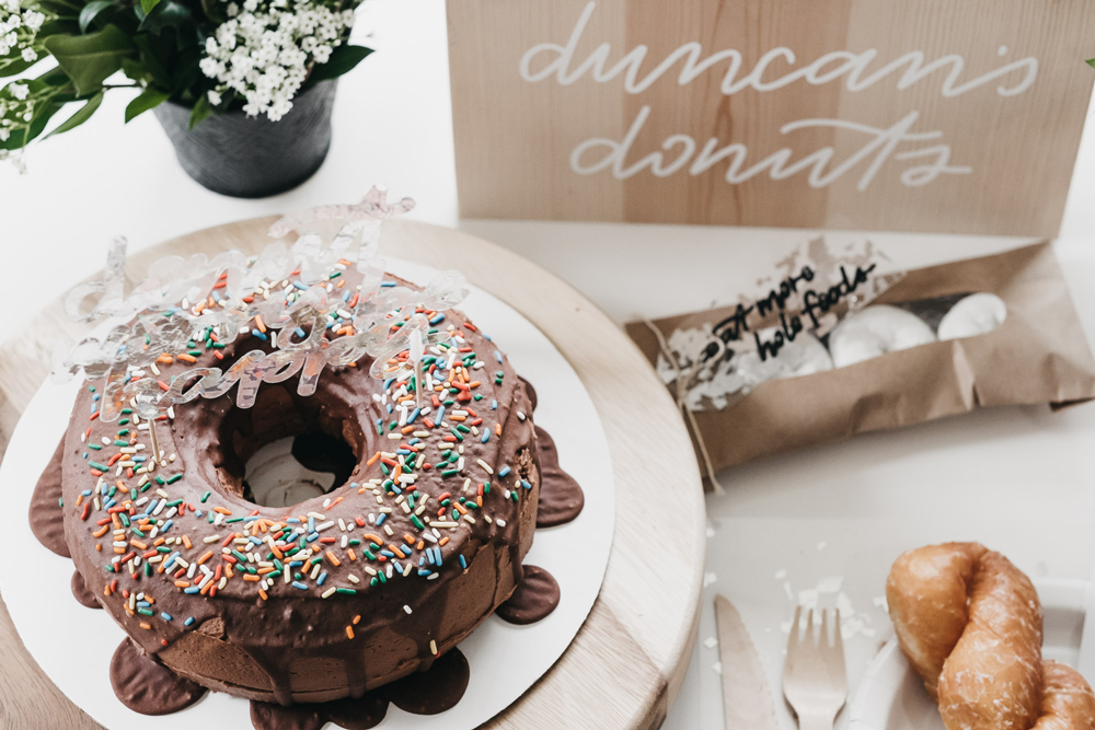 Donut party, doughnut party, first birthday party ideas, doughnut jokes, donut phrases, donut sign, doughnut sign, doughnut birthday ideas, donut birthday ideas, first birthday ideas, boys birthday party, 100 layer cake party, boys first birthday ideas, doughnut pegboard, donut pegboard, donut display wall, doughnut display wall, chic boys party, painted playhouse, white playhouse, playhouse makeover, outdoor play house makeover, donut cake, doughnut cake