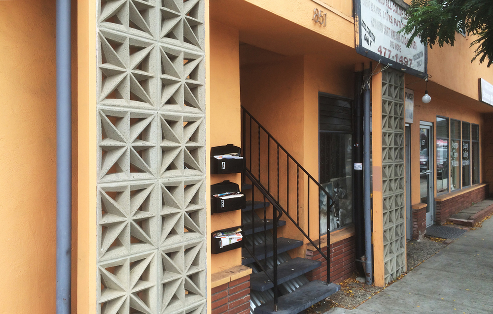 41st Ave Storefront Exterior Stairway Before