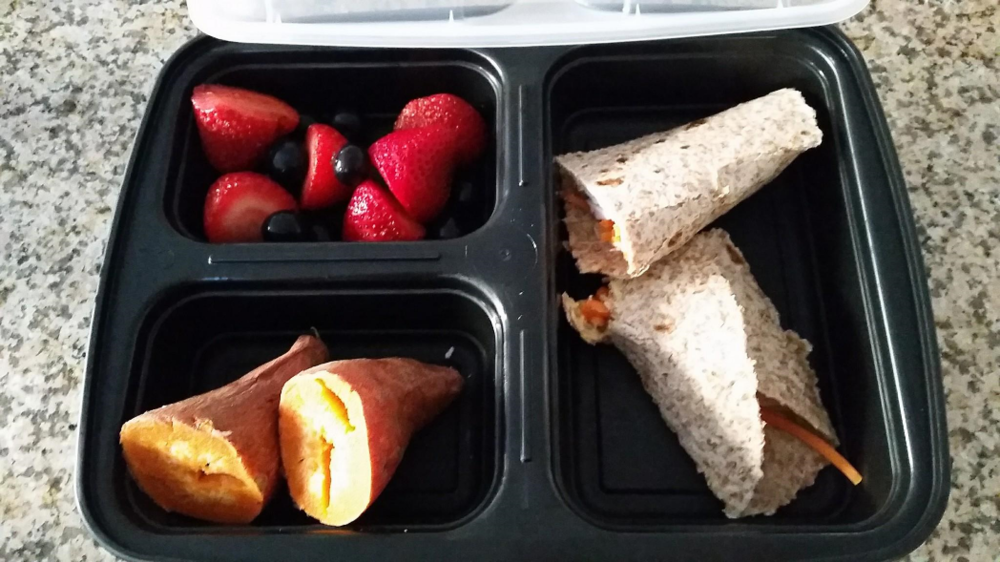 Healthy Lunch Idea - Ezekiel sprouted grain wrap with roasted turkey, carrots, and hummus; Berries; Sweet Potato