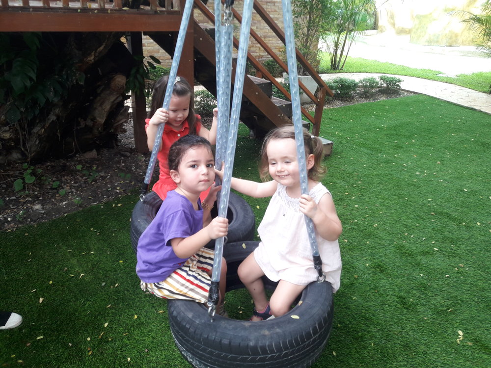 Sharing some friend time on a tire swing