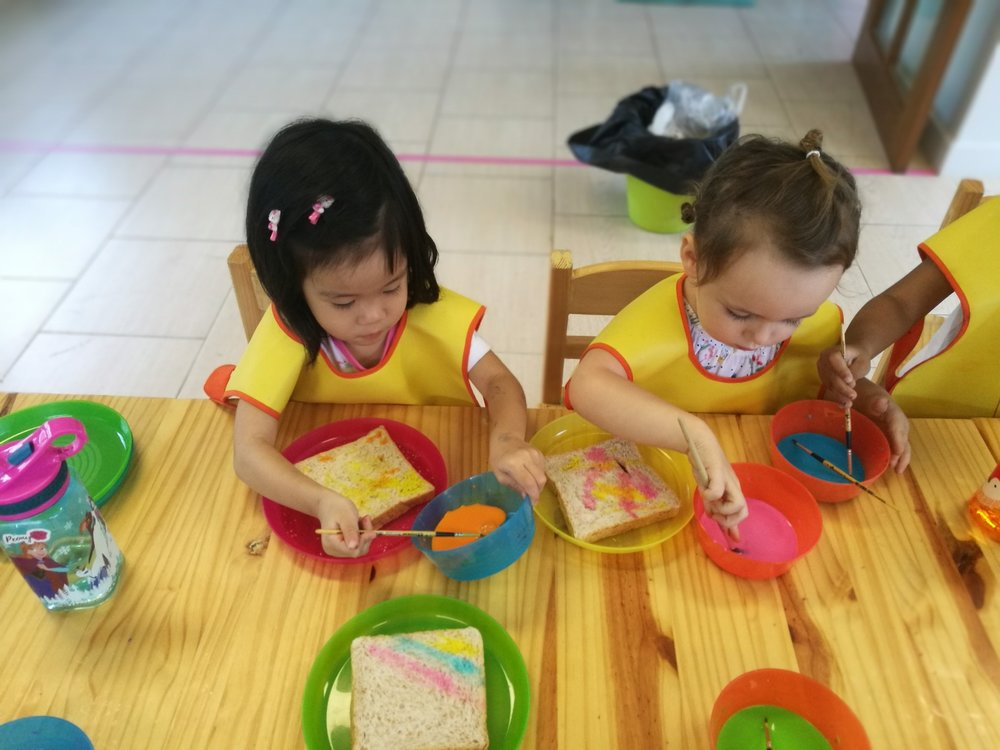 Making colorful rainbow toast during cooking class.
