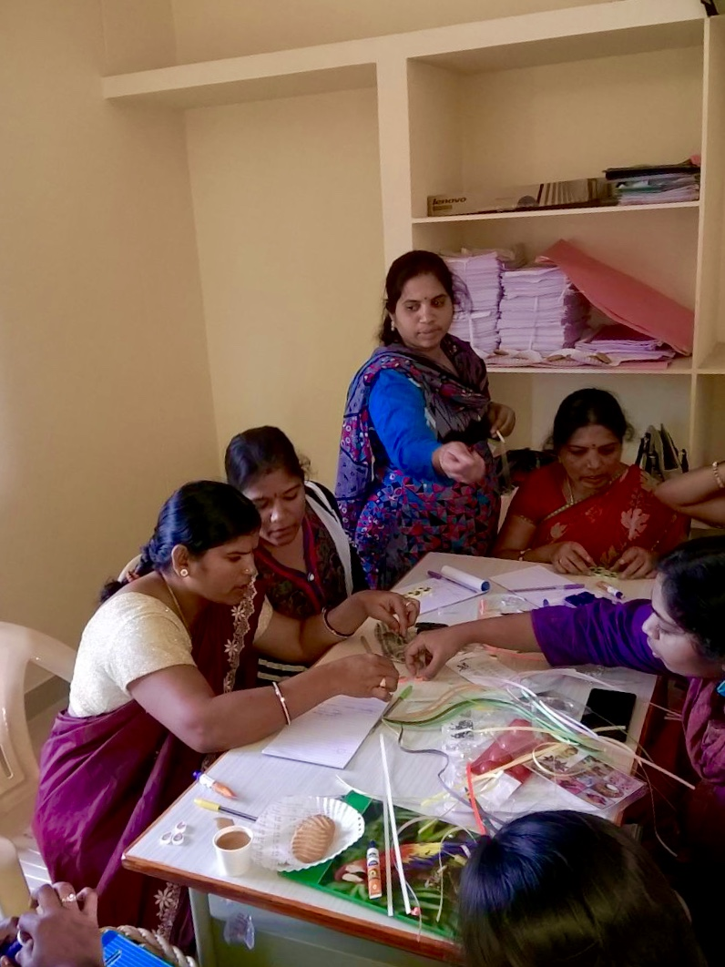 Teachers learning to make earrings before training students