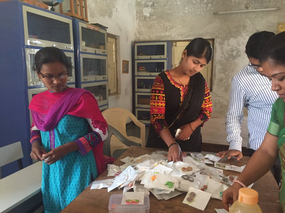 Yuva Nestham staff conduct a quality check on a new batch of earrings