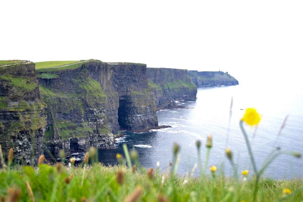 cliffs of moher  - Get ready for breathtaking + peaceful views when visiting the cliffs. If we ever have the chance to go back to Ireland, I would like to rent a car so we could have a picnic and leisurely spend the day here.