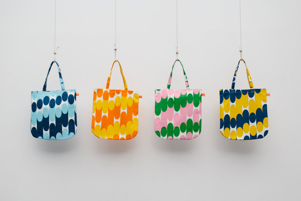 Above: Tote bags by Laura Spring