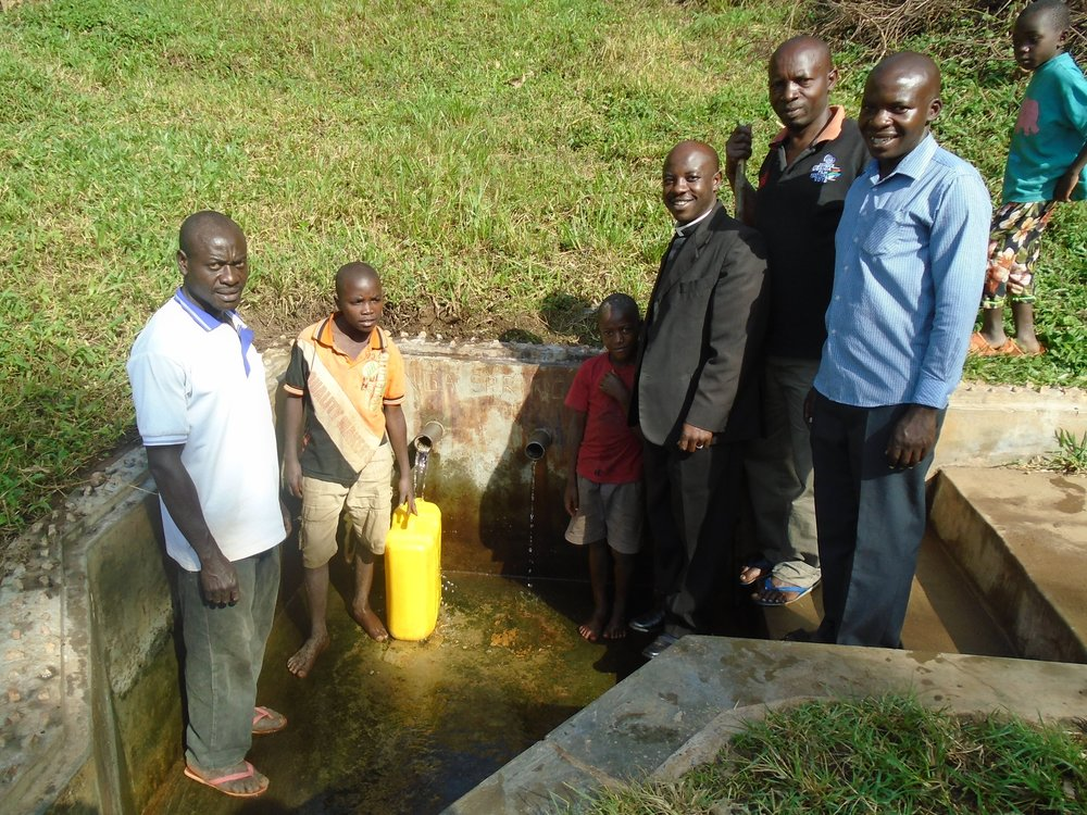 Kyeijanga spring with Moses on completion.jpg