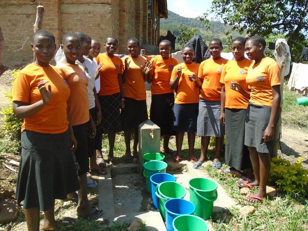 Burema school girls at tapstand on washing day.jpg