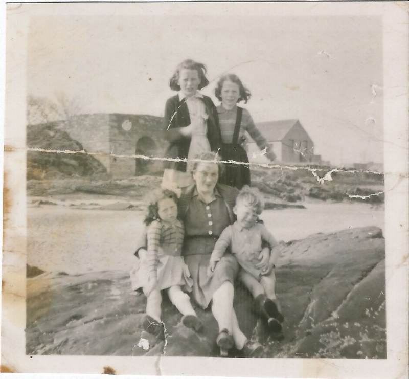 My Granny Rosaleen on Ballywalter Beach in the late 1940s with my Mum top right and my Aunt Joyce bottom left. The building on the right of my Mum was my Grandad's garage and their house was next door.