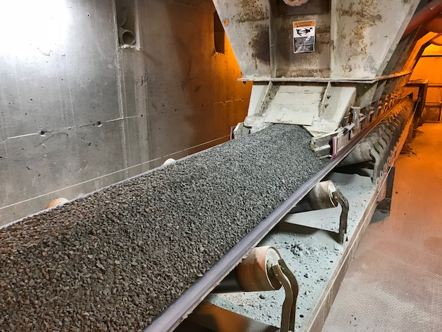 Conveyor below fine ore bin.