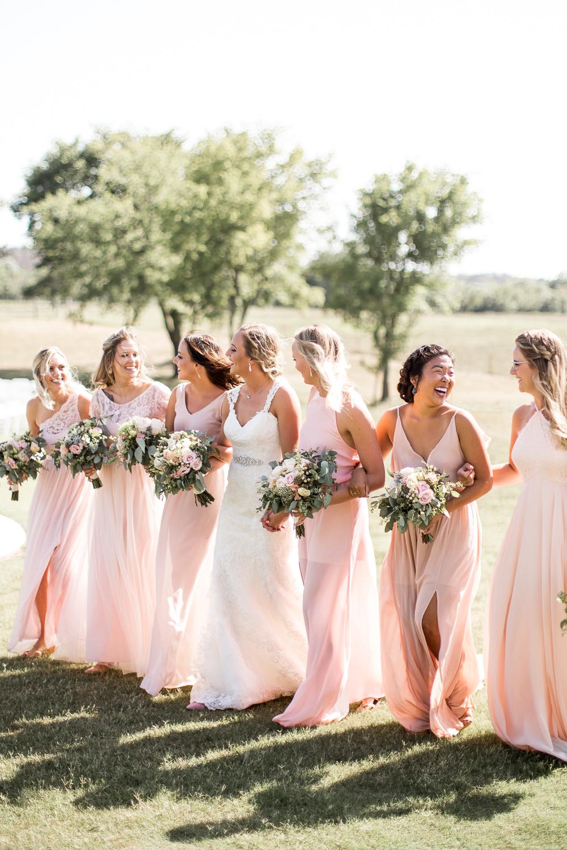bridesmaids walking together at Rick's Place in Tulsa, Oklahoma