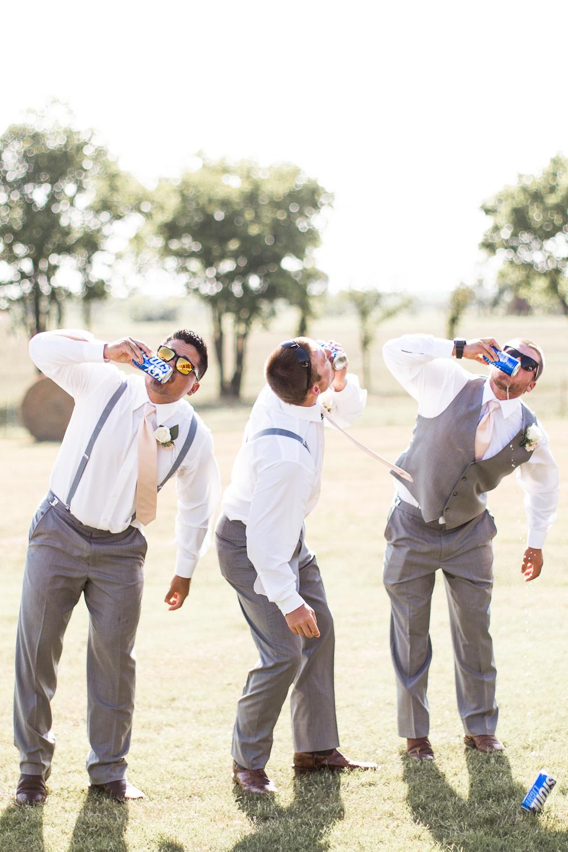 groomsmen shotgunning keystones