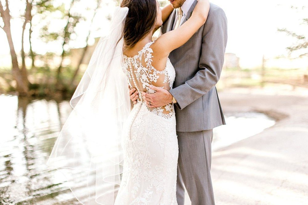 Here, Taylor was shooting wide and perpendicular to the couple, so I stood to the side and got a tight shot focusing on the back of her dress and the way his hands were gently touching her.