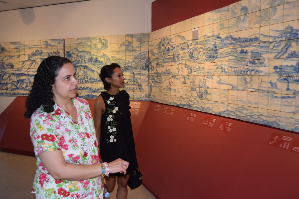 Sheree Mitchell with Dra.Constanza Acevedo Lima as she explains the City of Lisbon tile mural