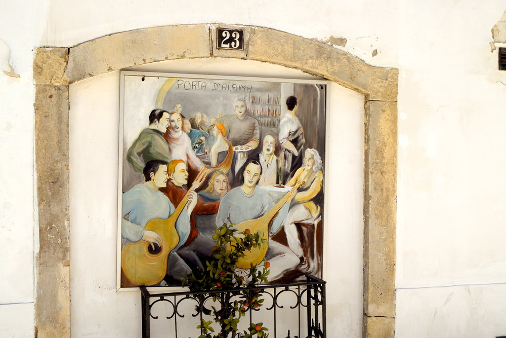 A typical hand-painted mural in Alfama