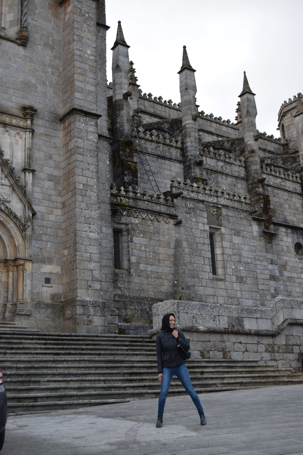 "sheree M. mitchell  ""posing"" in the rain in front of se da guarda (guarda cathedral) in guarda, portugal"
