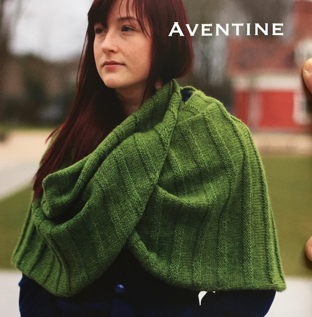 "Aventine  This shawl is knit from the bottom tip outwards, when finished it can be worn as a standard scarf or shawl, or alternatively crossed at the front and buttoned for an elegant, draped wrap.   Yarn:  Baa Ram Ewe Dovestone DK (252yds / 230m per 100g)  Yarn Quantities:  1000 yards (914 m)   Needles:  4.5mm x 60cm circular  Notions:  6 x 20mm buttons  Size:  total width 77.5""/ 197 cm"