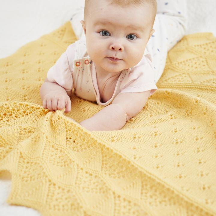 Aphaca_blanket_by_Donna_Smith_knitted_in_Something_to_Knit_With_4ply_shade_Beach_09e618b6-8a9f-4e99-88ad-650d3f8ce4f2_720x.jpg