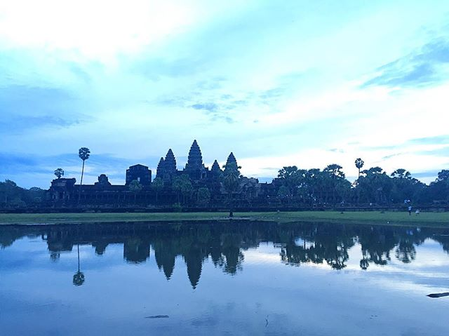 Woke up at the crack of dawn to watch the sunrise at Angkor Wat. I'll be honest and say I didn't realize the sun has fully risen because it was a little bit cloudy and the traditional sunrise hues were absent. Still amazing though! #SanTranTravels #angkorwat #temples #siemreap #travel #wanderlust