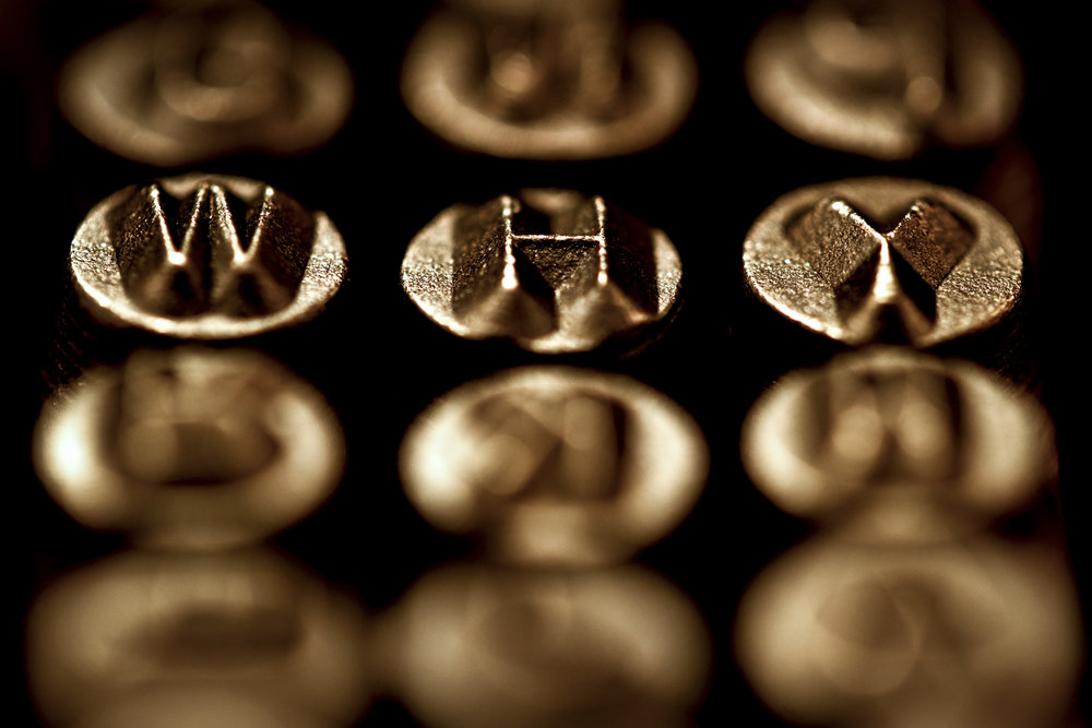 Shallow depth of field puts the focus where the photographer wants it. In this case, it highlights the letters spelling the word 'Why' while the other letters in the set are out of focus.