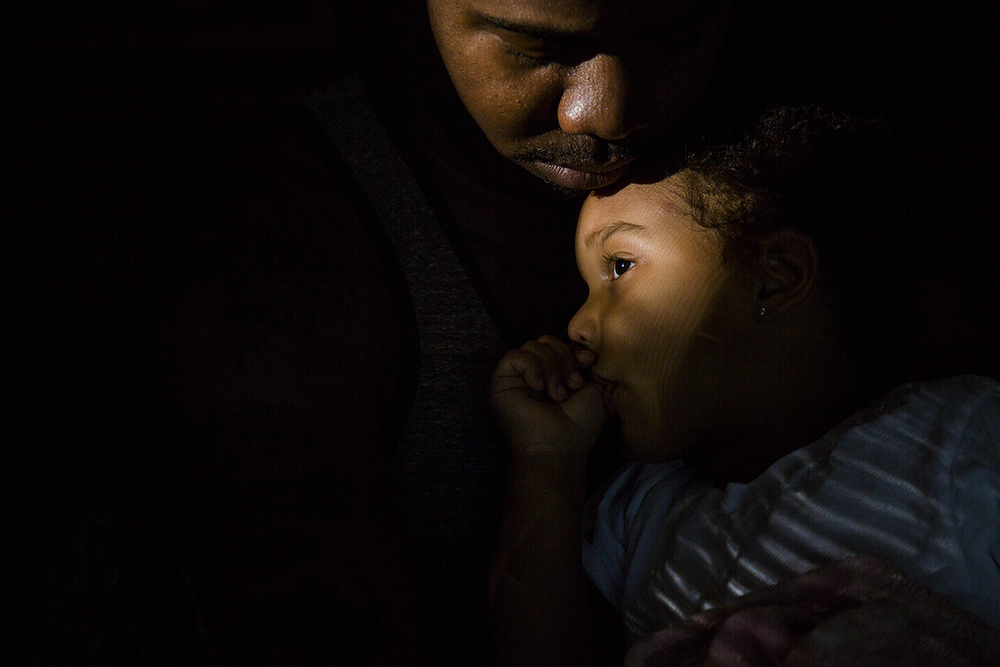 Marques Nash comforts his daughter Demi after a long day of visiting friends and family in Matthews, N.C. on Sunday, May 5, 2015. Nash has an informal custody agreement with Demi's mother which allows them to share the responsibility of caring for her. Fatherhood has given him a new purpose in life outside of his desire to become a musician.