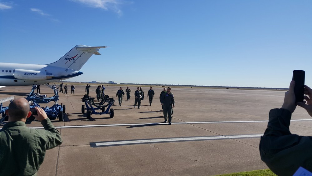 The Made In Space team coming off of the FOP aircraft used for microgravity testing in Houston, TX