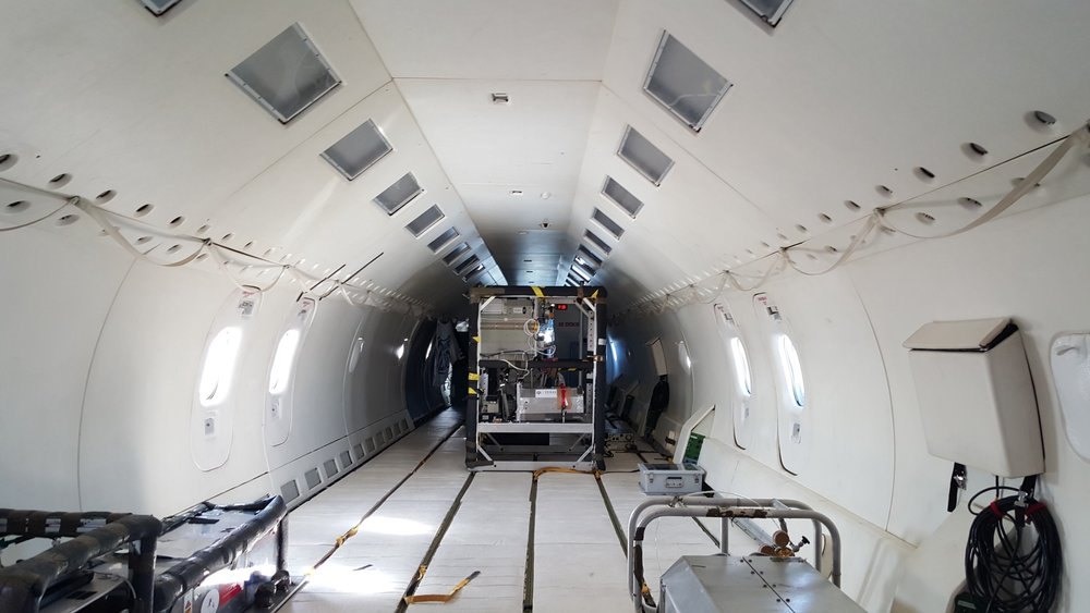 The interior of the parabolic flight aircraft. Note the padded walls, floor, and ceiling.