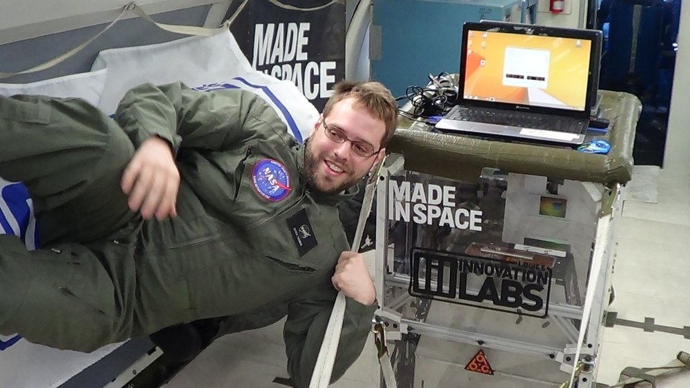 Made In Space material scientist holds on tight while the FOP aircraft flies a microgravity parabola