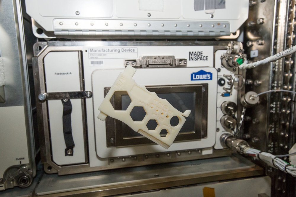 A 3D printed multi-tool, designed by students in the Future Engineers program, floats in front of Additive Manufacturing Facility on the International Space Station | Image credit: NASA