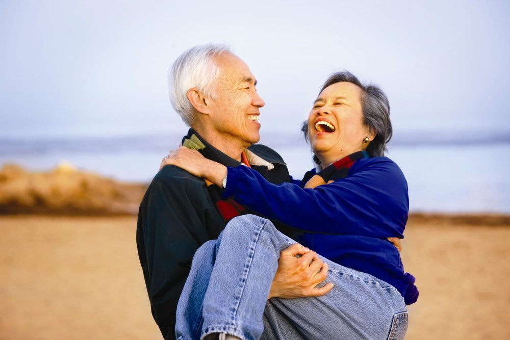 old-couple-on-beach-at-sunset-happy.jpg