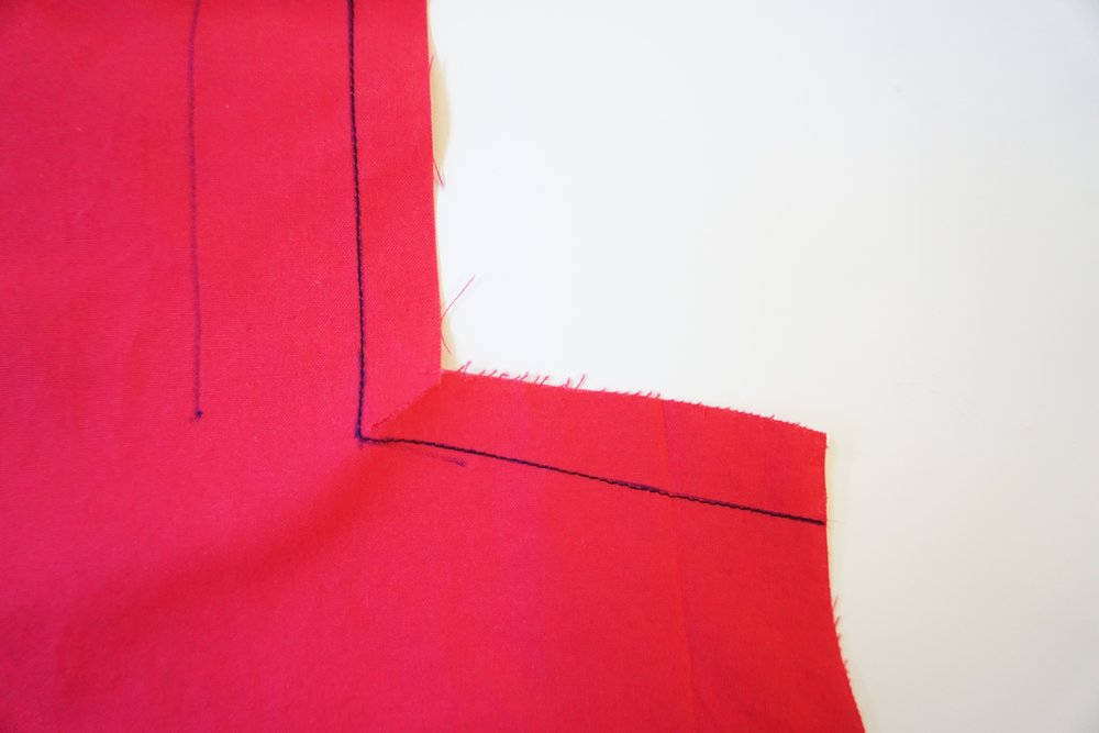 Step 1:  REINFORCE  the inner circle on the front bodice by stitching from the top, pivoting at the circle and continue stitching to the side.  REINFORCE : stitch along seamline where indicated, using small machine stitches.  (Always check the Glossary in your pattern instructions for any  BOLD  words you're not familiar with)