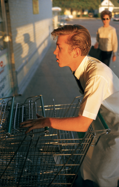 Untitled [Supermarket boy with carts], Memphis by      William Eggleston.