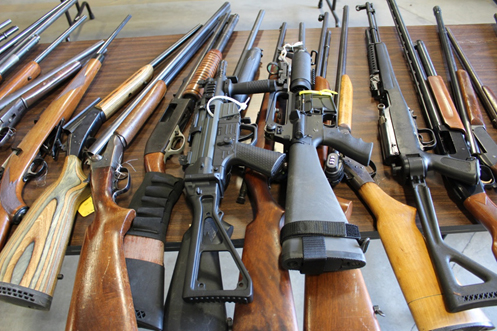 A sample of the rifles and shotguns that were destroyed image