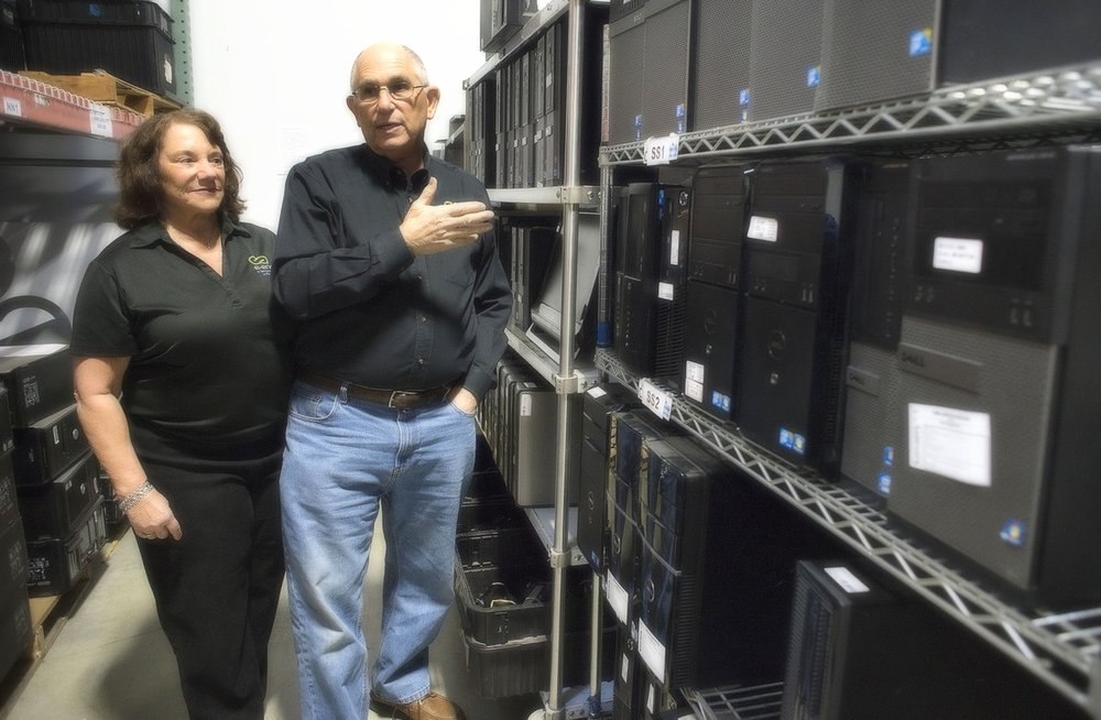 Arleen and Steve Chafitz, owners of e-End in Frederick with refurbished computers for sale.