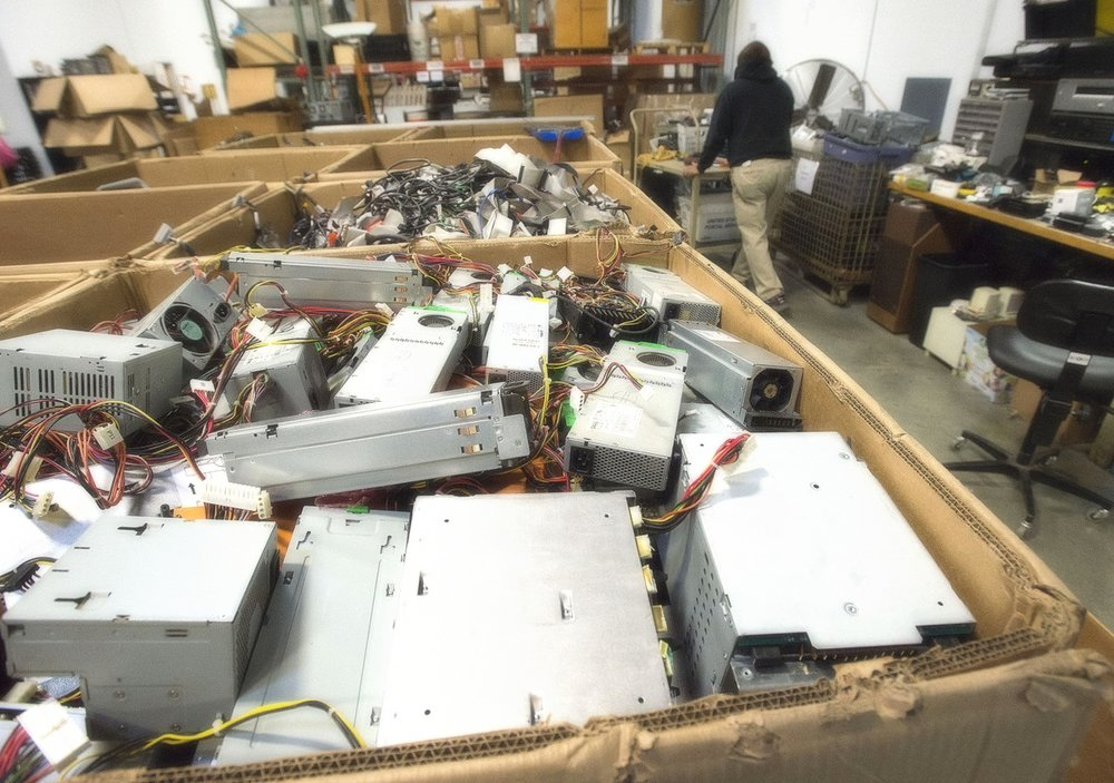 Computer components in boxes waiting to be recycled at e-End in Frederick.