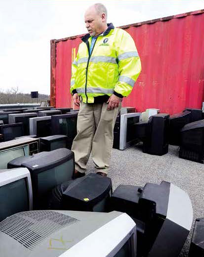 Tony Dury, recycling program coordinator for the Washington County Division of Environmental Management, surveys cathode ray tube (CRT) televisions dropped off for recycling. These are the most expensive items to recycle because of the amount of hazardous lead in each screen.
