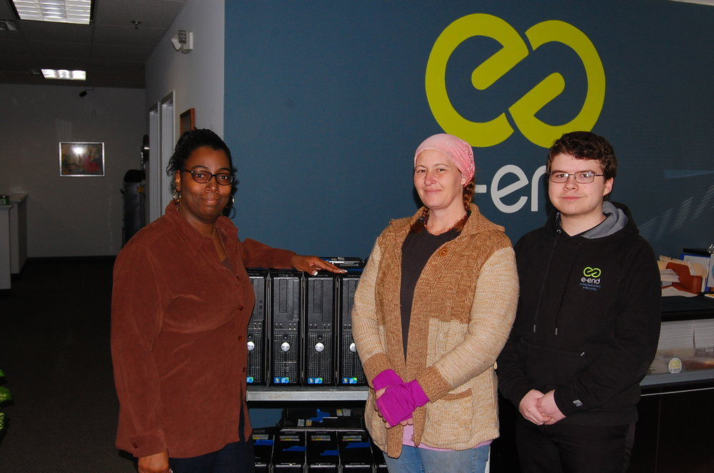 Two of our team members, who prepared the computers for use (right), Maria & Jakob, presenting Mrs. Green (left) with equipment
