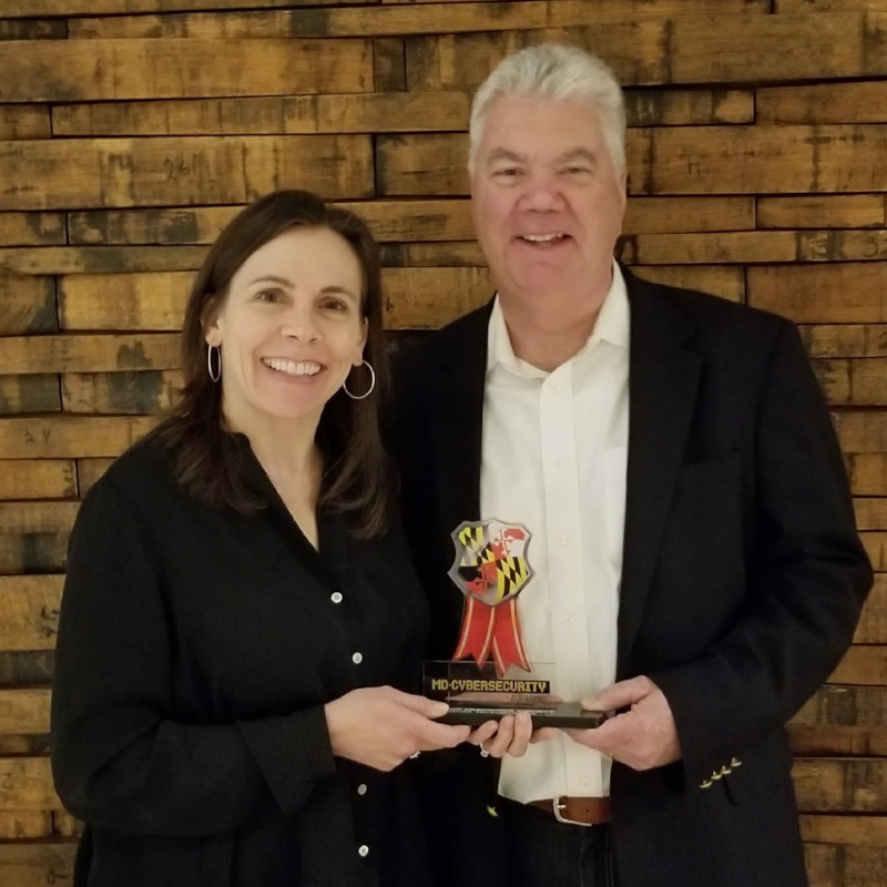 Receiving the Cyber security Award for Patriot Technologies is Hatie Heister, Director of Sales Operations and   Steve Keefe  . President & CEO.