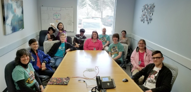 Members of the Robo Rangers, parents and mentors in a meeting room for an overview presentation of e-End's services.