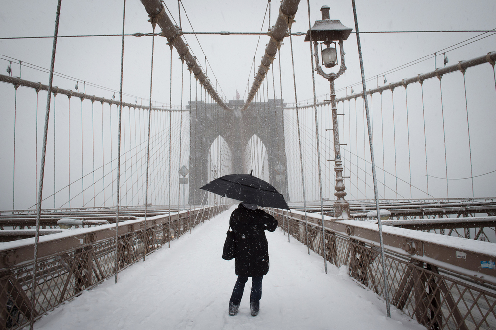 A pedestrian on The Brooklyn Bridge as a snowstorm hits the Metropolitan area, Thursday, March 5, 2015.