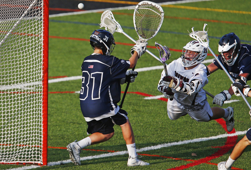 Ridgewood's Jack Kiernan (26) dives as he takes a shot for a goal against Pingry goalkeeper David Metzger (31) during round one of boys lacrosse Tournament of Champions at Bridgewater-Raritan High School. Bridgewater, NJ  5/30/15
