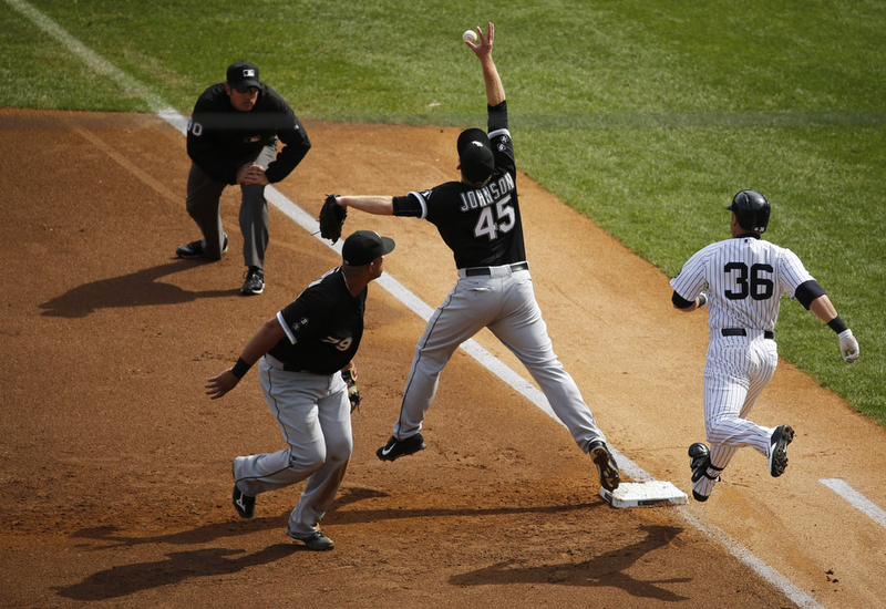 White Sox first baseman Jose Abreu flips too high which pulls pitcher Erik Johnson off the base for an error allowing Calros Beltran to reach safely in the first inning as the New York Yankees host the Chicago White Sox at Yankee Stadium. 9/27/15 Bronx, NY