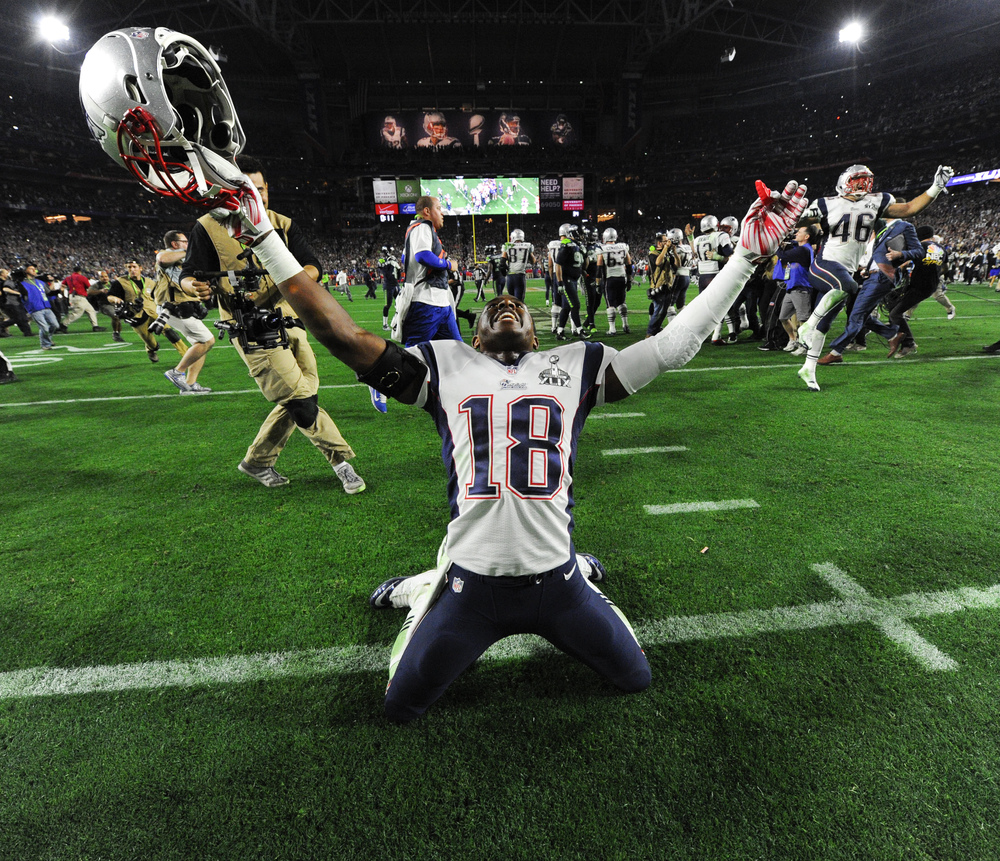 Feb 1, 2015; Glendale, AZ, USA;New England Patriots wide receiver Matthew Slater (18) celebrates the Patriots victory in Super Bowl XLIX at University of Phoenix Stadium.