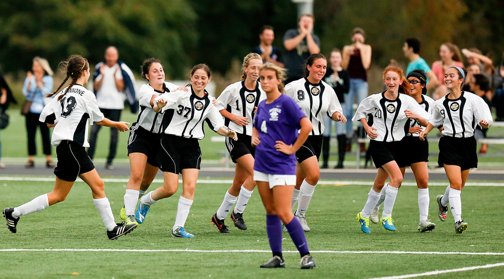 Jacqueline Moss of Tech High School is congratulated after scoring against cross town rival Tottenville during the 2-1 victory in Staten Island, NY. They lost to Tottenville earlier in the year. 10/9/15