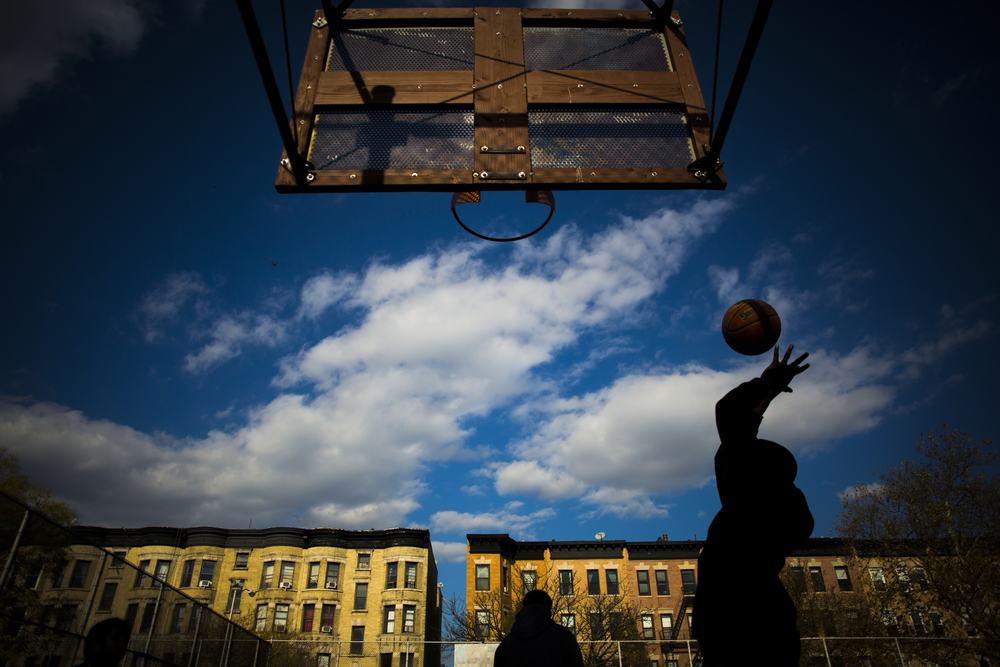Friday, November 13, 2015  Children play a game of basketball at Stroud Playground in Prospect Heights, Brooklyn, New York.