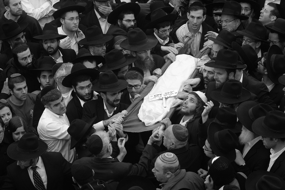 Seven young members of the Sasson family killed in a fire in their Midwood home on Saturday, were laid to rest in a cemetery in Israel. 3-19-15
