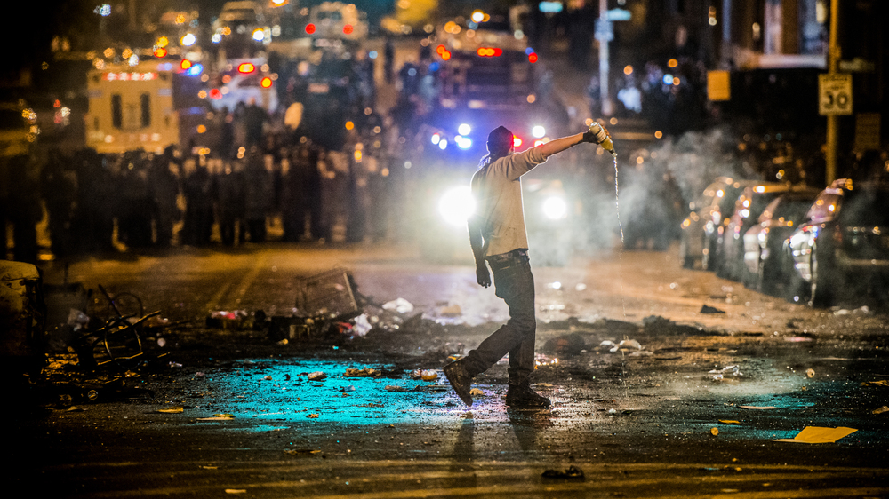 BALTIMORE: A CITY ON FIRE protestors clash with police at west Worth and Fulton in Baltimore, Maryland.