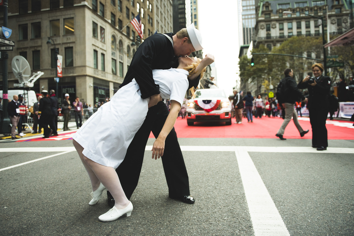 "a couple imitate the iconic photograph ""V-J Day in Times Sq"" at Veterans Day Parade NYC on Wednesday November 11, 2015 in Manhattan