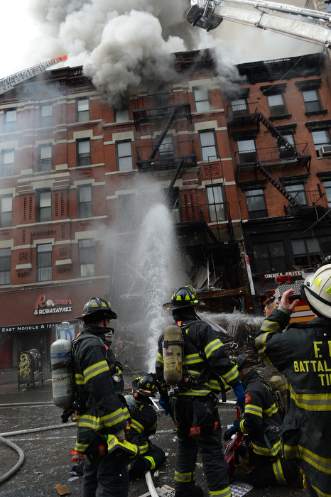 Firefighters try to stop a quick moving gas fed gas explosion in a restaurant on the first floor of a five story building but are overwhelmed by the fire sweeping up though that building and two others on Second Avenue in Manhattan in one of the biggest gas explosion fires in recent memory.  3-26-15