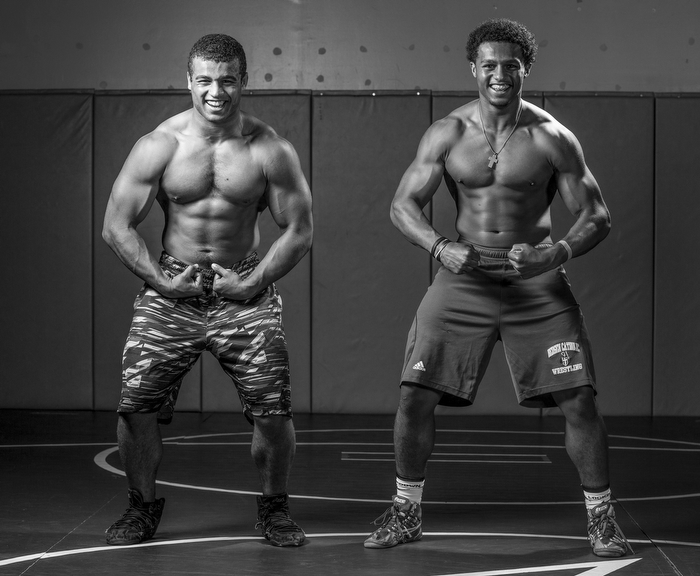 Brothers Matt (left) and Josh McKenzie pose for a portrait during a workout at Triumph Wrestling Club in June. Matt is a sophomore at Wall High School and Josh, who repeated the 8th grade, is an incoming freshman at Bergen Catholic 80 miles to the north.
