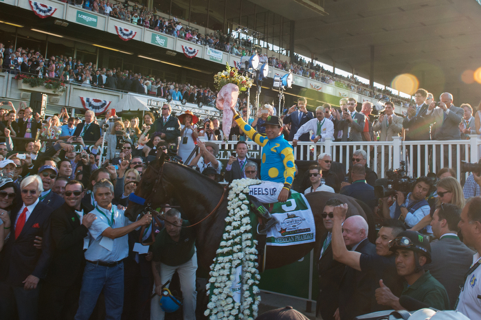 American Pharoah with Victor Espinoza up and trained by Bob Baffert, left, returns to the winner'c circle as he wins the 147th running of the Belmont Stakes, Grade I - $1,500,000, and is now Triple Crown winner, Belmont Park, Saturday June 6, 2015.